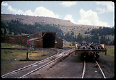 Flat car - scrap in Cumbres Pass. Snow shed to right.<br /> D&amp;RGW  Cumbres Pass, CO