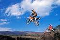 French Cyrill Despres jumps on his KTM 250 EXC motorcycle at the foot of Mount Fuji (Japan) on November 2001. (Photo credit Laurent Benchana/Nippon News)
