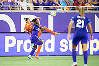 Orlando, Florida - Saturday, April 23, 2016: Houston Dash defender Poliana Barbosa (2) flips the ball over the head of Orlando Pride forward Jasmyne Spencer (23) during an NWSL match between Orlando Pride and Houston Dash at the Orlando Citrus Bowl.