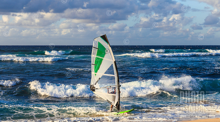 A windsurfer coming in to shore at Ho'okipa Beach on Maui.
