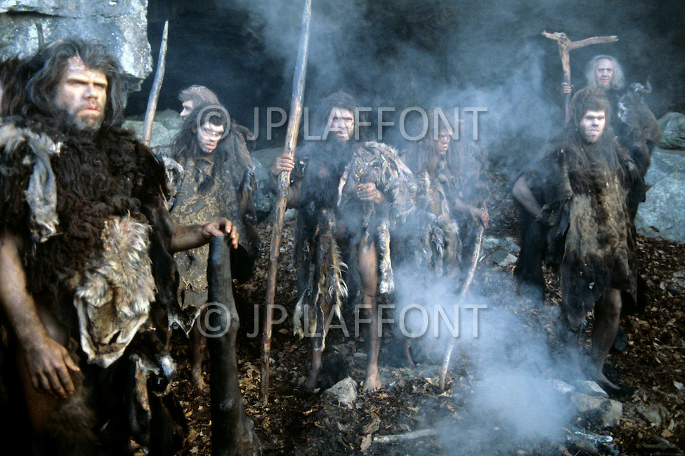 """Toronto area, Canada.1981. 80,000 years ago, the tribe who posessed fire, posessed life. A primitive tribe try to keep a natural fire source for survival.  This part of the movie was filmed in Canada.  """"Quest for Fire"""" (La guerre du feu) by French director Jean-Jacques Annaud, and based on the novel of JH Rosny. Scene of the tribe around their fire."""