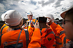 © Joel Goodman - 07973 332324 . 05/08/2016 . Cheshire , UK . CHRIS GRAYLING talking to media during a visit to the A6 relief road construction site , near to Manchester Airport , on his first visit to the North West since he was appointed Transport Secretary . Photo credit : Joel Goodman