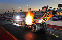 Jan 25, 2009; Chandler, AZ, USA; NHRA top fuel dragster driver Tony Schumacher launches off the starting line during testing at the National Time Trials at Firebird International Raceway. Mandatory Credit: Mark J. Rebilas-