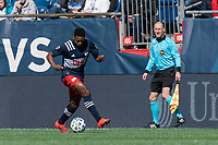 FOXBOROUGH, MA - MARCH 7: DeJuan Jones #24 of New England Revolution brings the ball forward during a game between Chicago Fire and New England Revolution at Gillette Stadium on March 7, 2020 in Foxborough, Massachusetts.