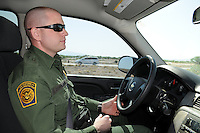 Tucson, Arizona - U.S. Customs Border Protection (CBP) Public Affairs Officer Jeremy Copeland drives a group of journalists to city of Nogales from Tucson. He transported reporters to the U.S.-Mexico border during a two-day event organized by the Tucson Sector Border Patrol. The event brought national and international journalists to the Arizona border to become acquainted with the dynamics of this area. Photo by Eduardo Barraza © 2012