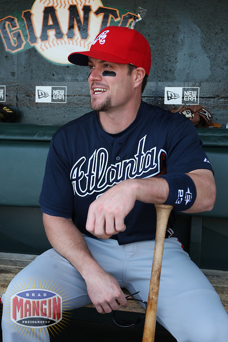SAN FRANCISCO - MAY 25:  Matt Diaz #23 of the Atlanta Braves gets ready in the dugout before the game against the San Francisco Giants at AT&T Park on May 25, 2009 in San Francisco, California. Photo by Brad Mangin