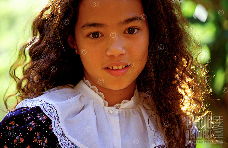 Close-up of a beautiful nine year old Chinese American girl wearing an old fashioned dress.