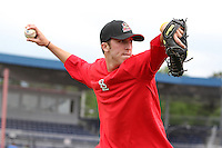 Batavia Muckdogs pitcher Corey Baker throws in the outfield during the first day of practice for the start of the NY-Penn League season at the Dwyer Stadium in Batavia, New York;  June 13, 2011.  Photo By Mike Janes/Four Seam Images