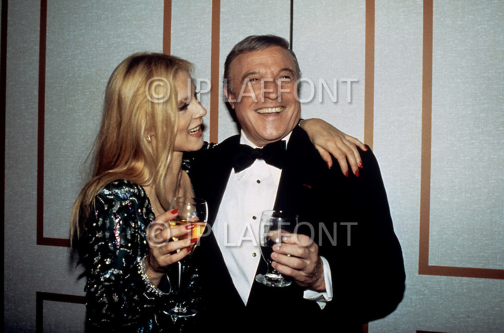 Las Vegas, U.S.A, December, 1982. French singer Sylvie Vartan with  Gene Kelly at the MGM Hotel.