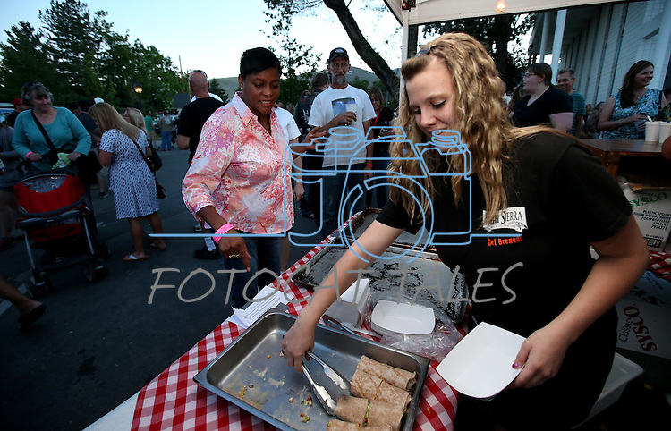 Mary Brown tries a sample at the High Sierra booth at the 20th annual Taste of Downtown event in Carson City, Nev., on Saturday, June 15, 2013. The event features 44 local restaurants in a fundraiser for the Advocates to End Domestic Violence.<br /> Photo by Cathleen Allison