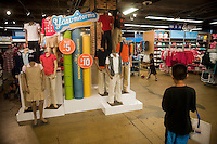 Back to school display is seen in a Old Navy store in New York on Friday, July 23, 2010. Stores are beginning to offer earlier than usual back to school specials. (© Richard B. Levine)
