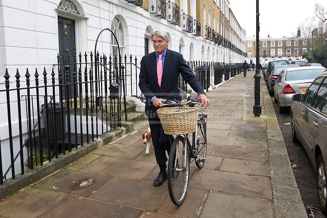 19/12/2012. London, UK. Former Conservative chief whip Andrew Mitchell is seen walking to work with his bicycle in London today (19/12/12) the day after CCTV footage was released that cast doubt on his alleged verbal abuse of Downing Street police officers . Photo credit: Matt Cetti-Roberts