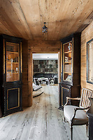 Bare wood floorboards run the length of the ground floor, from the dining room through to the reading room