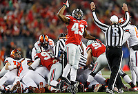 Ohio State Buckeyes linebacker Darron Lee (43) reacts after a fumble by Illinois that Ohio State recovered in the first quarter of the NCAA football game at Ohio Stadium on Saturday, November 1, 2014. (Columbus Dispatch photo by Jonathan Quilter)