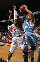 North Carolina forward James Michael McAdoo (43) shoots next to Virginia forward Akil Mitchell (25) during an NCAA basketball game against Virginia Monday Jan. 20, 2014 in Charlottesville, VA. Virginia defeated North Carolina 76-61.