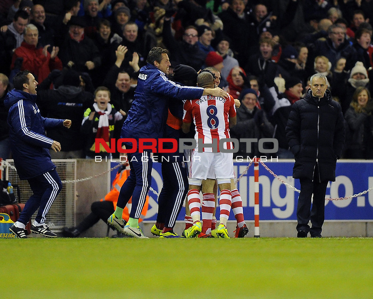 Stoke City's Oussama Assaidi celebrates his winning goal with team mates in front of a dejected Chelsea Manager, Jose Mourinho -   07/12/2013 - SPORT - Football - Stoke-On-Trent - Britannia Stadium - Stoke City v Chelsea - Barclays Premier League<br /> Foto nph / Meredith<br /> <br /> ***** OUT OF UK *****