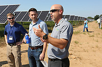 NWA Democrat-Gazette/DAVID GOTTSCHALK  Matt Irving (right), vice president of operations at Today's Power, describes Friday, September 6, 2019, the new solar array at the Westside Wastewater Treatment Plant following a flipping the switch ceremony in Fayetteville. The city of Fayetteville, Ozarks Electric Cooperative and Today's Power, Inc. partnered to bring the 10-megawatt solar system with 24 megawatt-hours of on-site energy storage to the city's two wastewater treatment plants.
