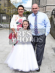 Ruby Grendon who received first holy communion in St Peters church West street pictured with her parents Darren and Joanne. Photo:Colin Bell/pressphotos.ie