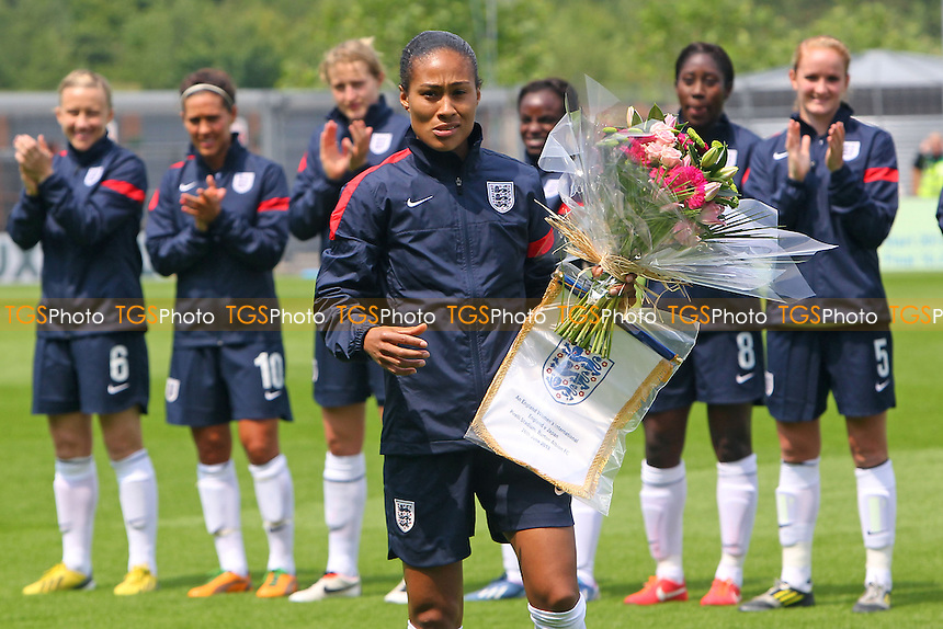 England captain Rachel Yankey receives flowers ahead of kick-off to mark her record 126th appearance for her country - England Women vs Japan Women - Friendly Football International at the Pirelli Stadium, Burton Albion FC - 26/06/13 - MANDATORY CREDIT: Gavin Ellis/TGSPHOTO - Self billing applies where appropriate - 0845 094 6026 - contact@tgsphoto.co.uk - NO UNPAID USE