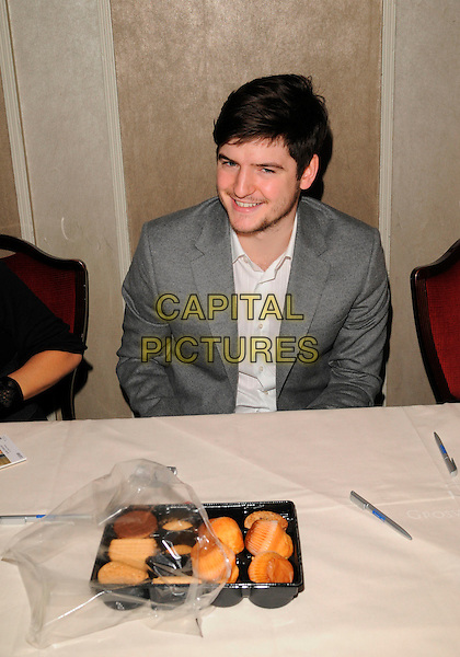 JAMES ALEXANDROU.At the Mad Hatters Tea Party, Grosvenor House Hotel, Park Lane, London, England, January 20th 2008..half length sitting grey jacket white shirt.CAP/CAN.©Can Nguyen/Capital Pictures