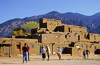 Clay houses and tourists at Taos Pueblo in New Mexico, USA