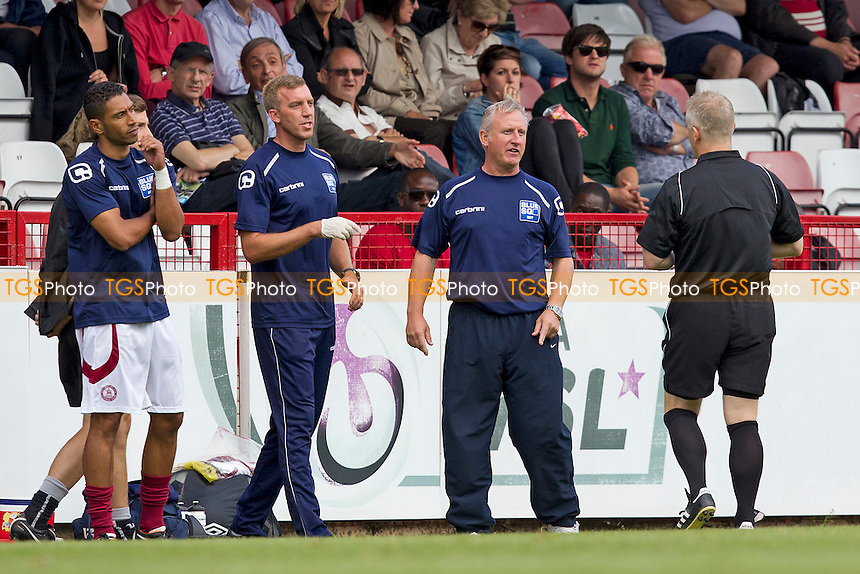 The Chelmsford Bench question the referee following Anthony Cook's straight red - Boreham Wood vs Chelmsford City - Blue Square Conference Football at Broughinge Road, Borehamwood, Hertfordshire - 27/08/12 - MANDATORY CREDIT: Ray Lawrence/TGSPHOTO - Self billing applies where appropriate - 0845 094 6026 - contact@tgsphoto.co.uk - NO UNPAID USE.