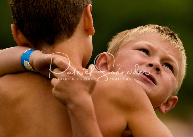 Boys compete in a wrestling competition during the 52nd Annual Grandfather Mountain Highland Games in Linville, NC.