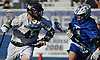 Logan Tucker #42 of Massapequa, left, charges downfield during the Nassau County varsity boys lacrosse Class A semifinals against Port Washington at Shuart Stadium, located on the campus Hofstra University in Hempstead, on Thursday, May 24, 2018. Massapequa scored six unanswered goals in the fourth quarter to win by a score of 11-3.