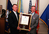 "United States Secretary of Defense William S. Cohen (left) presents a framed citation accompanying the Department of Defense Medal for Distinguished Public Service to Steven Spielberg (right) on August 11, 1999, in the Pentagon in Washington, D.C.  Cohen presented Spielberg the award in recognition of the impact his movie ""Saving Private Ryan"" has had on the American people.   According to the citation accompanying the medal, ""... Mr. Spielberg helped to reconnect the American public with its military men and women, while rekindling a deep sense of gratitude for the daily sacrifices they make on the front lines of our Nation's defense.""                                             Mandatory Credit: Helene Stikkel / DoD via CNP"