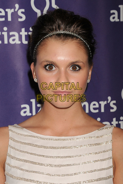 """Alexandra Chando.arriving at the 20th Anniversary Alzheimer's Association """"A Night At Sardi's"""" at The Beverly Hilton Hotel in Beverly Hills, California, USA, .March 21st, 2012..portrait headshot  hairband   white silver striped dress .CAP/ROT/TM.©TM/Roth Stock/Capital Pictures"""