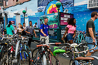 Brooklyn, NY - 12 July 2015 - Dozens of bicycles parked outside the busy Bedford Avenue subway station in Williamsburg Brooklyn