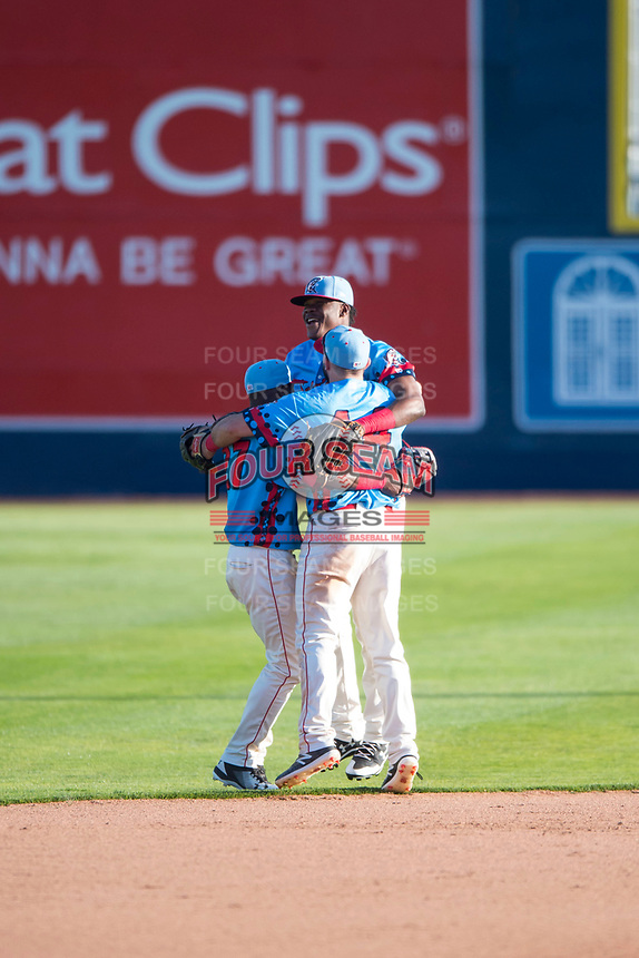 Spokane Indians outfielders Julio Pablo Martinez (27), Starling Joseph (39), and Tanner Gardner (44) celebrate after clinching their Division after a Northwest League game against the Vancouver Canadians at Avista Stadium on September 2, 2018 in Spokane, Washington. The Spokane Indians defeated the Vancouver Canadians by a score of 3-1. (Zachary Lucy/Four Seam Images)