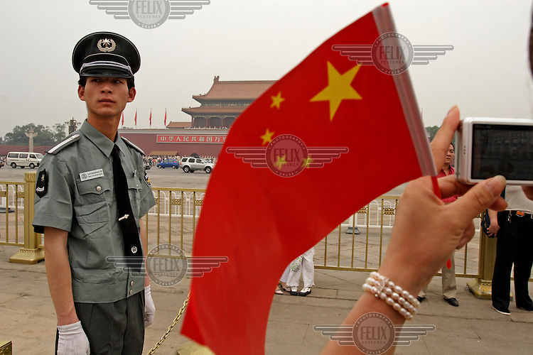 A People's Liberation Army soldier guards his post in front of Tiananmen Gate.
