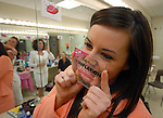Samantha Baudhuin shows her fellow contestants the kind of lips she wishes to have on February 16, 2008 prior to the start of the Miss Green Bay Area pageant at Bay Port High School in Suamico.  Baudhuin won the title of Miss Green Bay Area. Photo by Corey Wilson/Press-Gazette