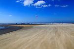Sandy beach and kite surfer, Conil de la Frontera, Cadiz Province, Spain