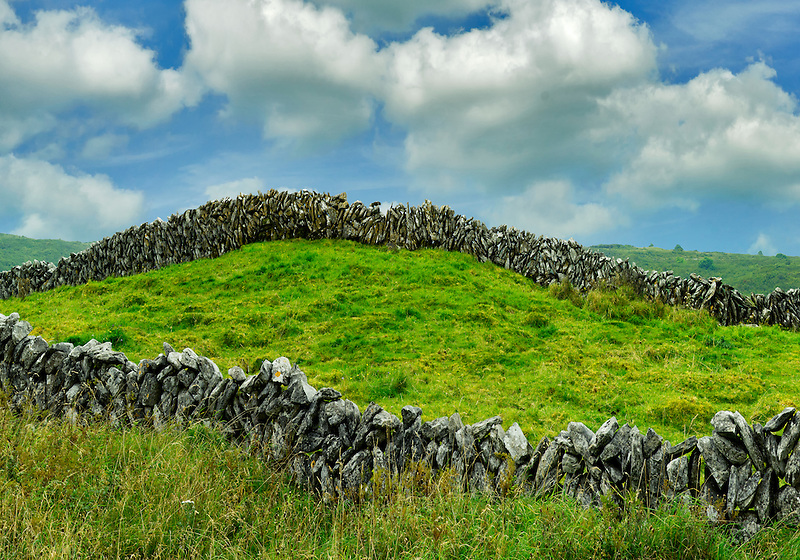 Rock fence and clouds in The Burren. Ireland.