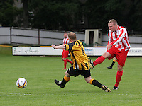 Neil Erskine shoots despite the challenge from Mark Gray in the Huntly v Wigtown & Bladnoch William Hill Scottish Cup 1st Round match, at Christie Park, Huntly on 25.8.12.