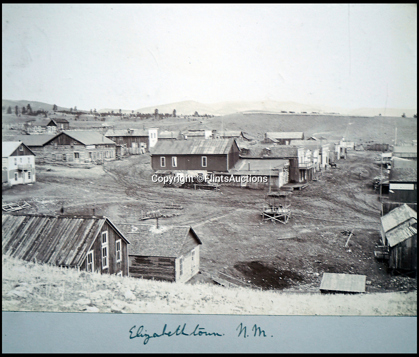 BNPS.co.uk (01202 558833)<br /> Pic: FlintsAuctions/BNPS<br /> <br /> The mining community of Elizabethtown in New Mexico - now a ghost town.<br /> <br /> Fascinating previously unseen early photos of cowboys in the Wild West have come to light 130 years later.<br /> <br /> They show life on the ranches of Colorado and New Mexico in the vast expanses of the south west US in the 1880s.<br /> <br /> One dramatic image captures the thrilling moment a group of cowboys ride towards the camera with hats held aloft.<br /> <br /> The photos are thought to have been taken by a British farmhand who travelled Stateside in the late 19th century to earn a living.