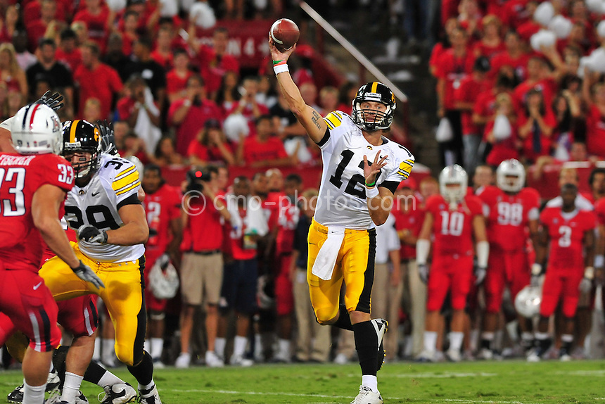 Sept 18, 2010; Tucson, AZ, USA; Iowa Hawkeyes quarterback Ricky Stanzi (12) throws a pass that was later intercepted by Arizona Wildcats cornerback Trevin Wade (not pictured) in the 1st quarter of a game at Arizona Stadium.