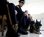 East Windsor Police Officer David McNeice smiles as he looks down as his dog Mack who is making some noises while they listen to East Windsor Police  Chief Edward J. DeMarco speak at the start of an awards program, Thursday, May 20, 2010, the canine team among the award winners. (Jim Michaud/Journal Inquirer)