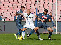 Jorginho   Massimo Maccarone   David Lopez    in action during the Italian Serie A soccer match between   SSC Napoli and Empolii    at San Paolo   stadium in Naples , December 07, 2014