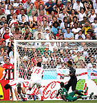14 June 2006: Zied Jaziri (TUN) (left) begins his celebration in the 23rd minute as his shot bulges the back of the net. Tunisia tied Saudi Arabia 2-2 at the Allianz Arena in Munich, Germany in match 16, a Group H first round game, of the 2006 FIFA World Cup.