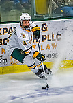 24 November 2012: University of Vermont Catamount defenseman Nick Bruneteau, a Junior from Omaha, NB, in third period action against the University of Minnesota Golden Gophers at Gutterson Fieldhouse in Burlington, Vermont. The Catamounts fell to the Gophers 3-1 in the second game of their 2-game non-divisional weekend series. Mandatory Credit: Ed Wolfstein Photo