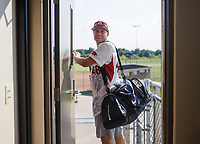 NWA Democrat-Gazette/CHARLIE KAIJO Matt Mika heads to the field during the Tyson Chicken annual softball tournament, Friday, August 3, 2018 at the Rogers Regional Sports Park in Rogers. <br />
