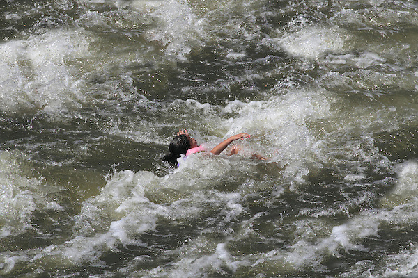 Girl drowning in river at Boulder Creek, Boulder, Colorado. .  John offers private photo tours in Denver, Boulder and throughout Colorado. Year-round.
