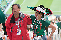 MOSCOW, RUSSIA - June 17, 2018:  Two fans have a photo taken together before the Germany vs. Mexico 2018 FIFA World Cup group stage match at Luzhniki Stadium