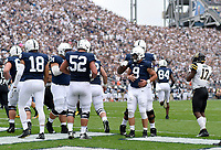 STATE COLLEGE, PA - SEPTEMBER 1:  Penn State QB Trace McSorley (9) rubs his stomach / midsection along with T Ryan Bates (52) while celebrating after scoring his first of two rushing touchdowns of the game. The Penn State Nittany Lions defeated the Appalachian State Mountaineers 45-38 in overtime on September 1, 2018 at Beaver Stadium in State College, PA. (Photo by Randy Litzinger/Icon Sportswire)