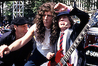 Brian Johnson Howard Stern and Angus Young. AC/DC Stills from their performance on the Howard Stern Movie. Location Bryant Park New York City July 2006