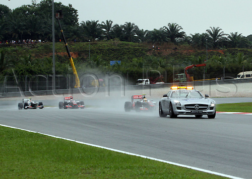 25.03.2012. Kuala Lumpur, Malaysia.  Formula 1 GP Malaysia in Kuala Lumpur The Safety Car comes out due to a heavy downpour at the F1 World Cup GP Malaysia Kuala Lumpur