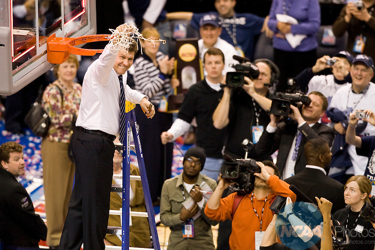 07 APR 2009:  Head Coach Geno Auriemma of the University of Connecticut cuts down the net after defeating the University of Louisville during the Division I Women's Basketball Championship held at the Scottrade Center in St. Louis, MO.  Connecticut defeated the University of Louisville 76-54 for the national title.  Matt Marriott/NCAA Photos